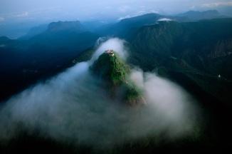 Adam's Peak, in southern Sri Lanka, emerges from the mornng mists.