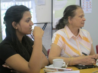 Vibha and Romy contemplate acrostic poetry